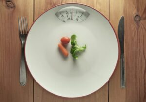 Anorexia Nervosa - characterized by limiting food intake